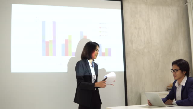 businesswoman presenting the financial report - financial report stock videos & royalty-free footage