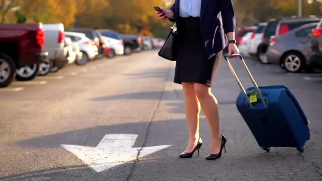 businesswoman pulling suitcase. - car park stock videos & royalty-free footage