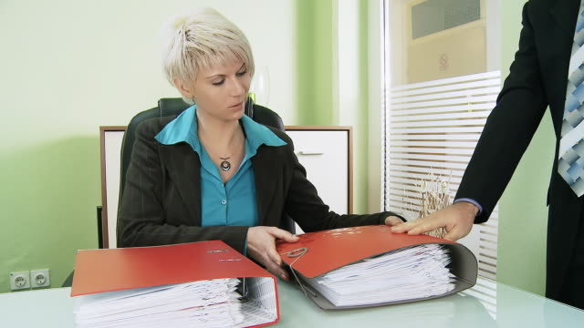 HD TIME-LAPSE: Businesswoman Receiving A Lot Of Paperwork