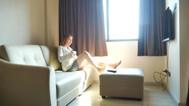 Businesswoman relaxing and watching TV