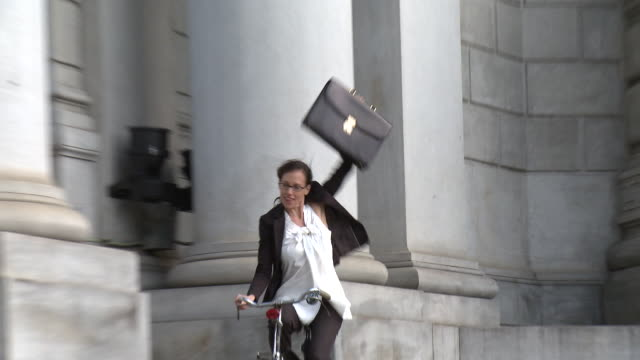 ms zo ws businesswoman riding bike with legs apart, new york city, new york, usa - legs apart stock videos and b-roll footage
