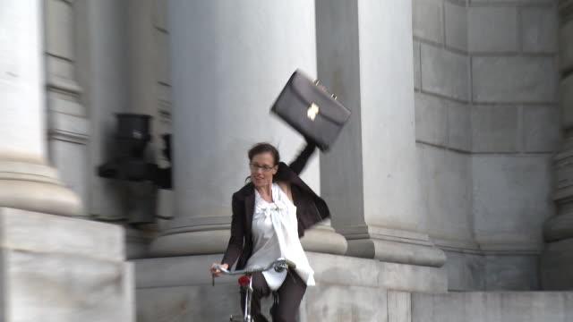 ms zo ws businesswoman riding bike with legs apart, new york city, new york, usa - legs apart stock videos & royalty-free footage