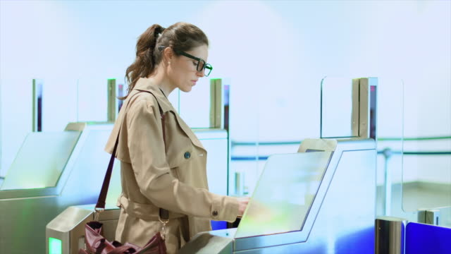 businesswoman scanning ticket - biglietto aereo video stock e b–roll