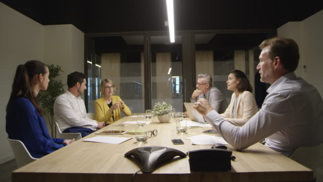 Businesswoman sharing ideas with coworkers