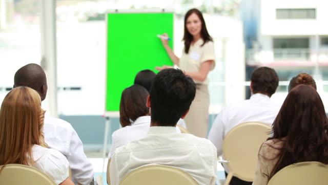Businesswoman showing a board