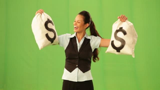businesswoman showing a dollar sack  - 宝くじ点の映像素材/bロール