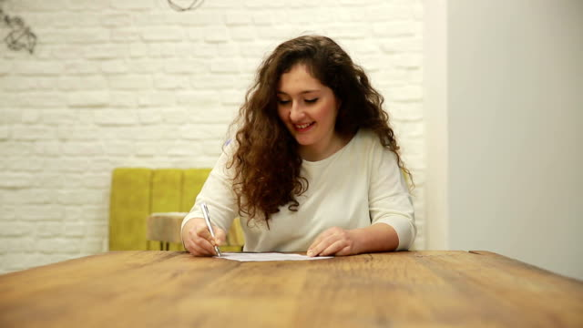 businesswoman signing contract paper - contract stock videos & royalty-free footage