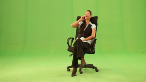 businesswoman sitting on a chair and talking on a mobile phone  - sitting stock videos & royalty-free footage