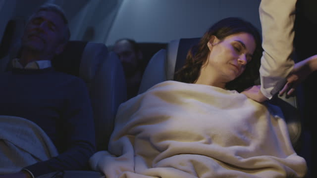 businesswoman sleeping in private airplane - passenger stock videos & royalty-free footage