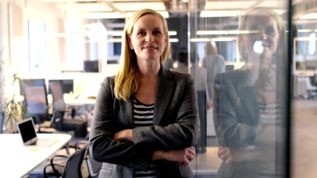 businesswoman standing arms crossed in new office - blazer jacket stock videos & royalty-free footage