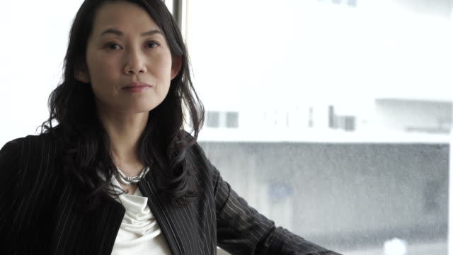 businesswoman standing by the window - only japanese stock videos & royalty-free footage