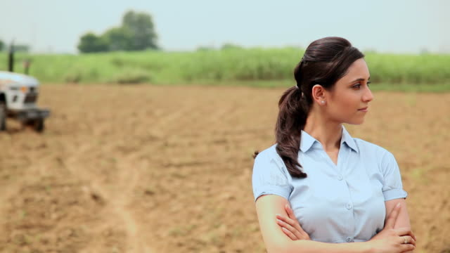 Businesswoman standing in a farm, Haryana, India