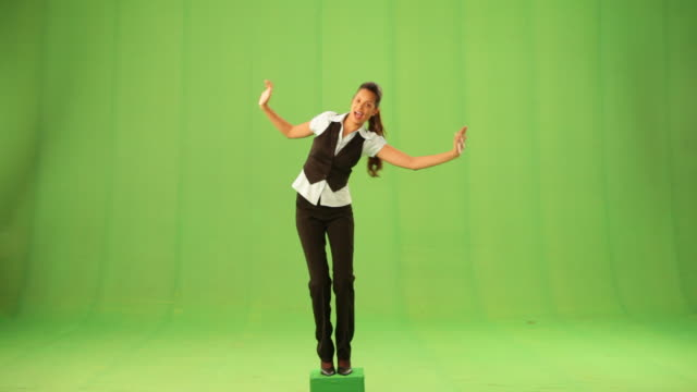 businesswoman standing on one leg  - on one leg stock videos & royalty-free footage