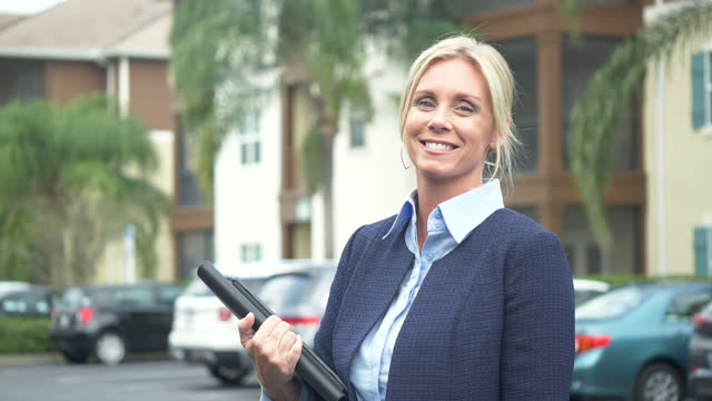 businesswoman standing outside building in parking lot - 40 49 years stock videos & royalty-free footage
