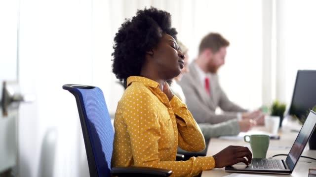businesswoman suffering from neckache - neckache stock videos & royalty-free footage