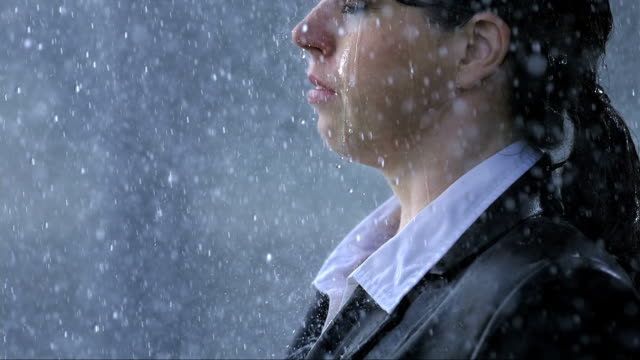 businesswoman surrendering to the rain - wet stock videos & royalty-free footage