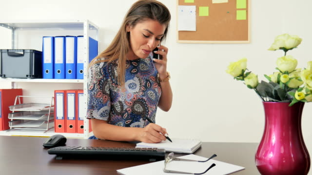 businesswoman taking a note in her office - personal organiser stock videos and b-roll footage
