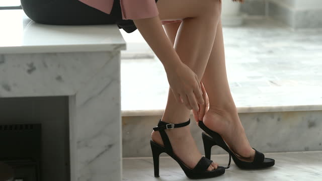 businesswoman taking on high heels shoes before go to work. - human foot stock videos & royalty-free footage