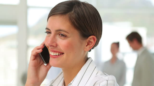 Businesswoman talking and listening to her mobile phone