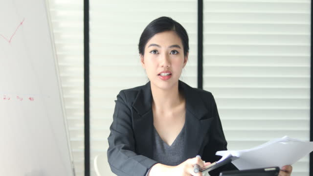 businesswoman talking during video conference - digital eyeball stock videos and b-roll footage
