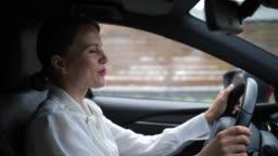 Businesswoman talking on in-car speakerphone