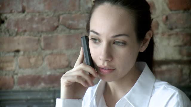 CU Businesswoman talking on mobile phone, New York City, New York, USA
