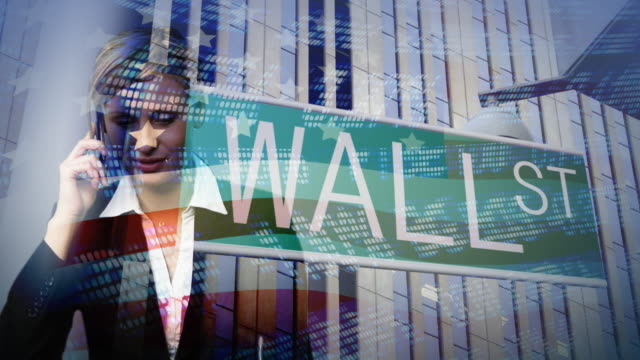 cu, multiple exposure, businesswoman talking on mobile phone with wall street sign and office building - borsa di new york video stock e b–roll
