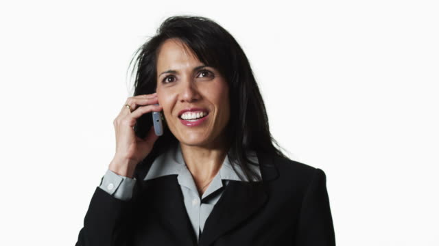 ms businesswoman talking on phone, against white background / orem, utah, usa - pacific islander background stock videos & royalty-free footage