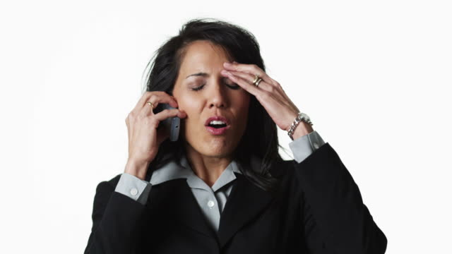 ms businesswoman talking on phone, against white background / orem, utah, usa - polynesiskt ursprung bildbanksvideor och videomaterial från bakom kulisserna