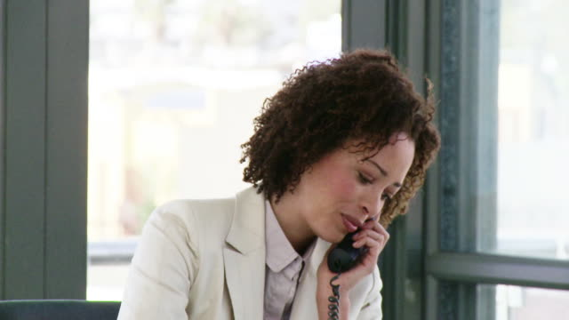 CU Businesswoman talking on phone, Cape Town, South Africa