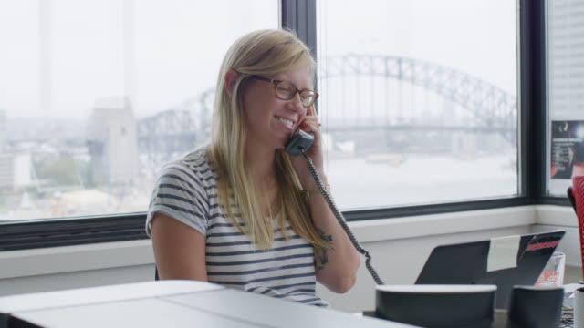 MS Businesswoman talking on phone in office