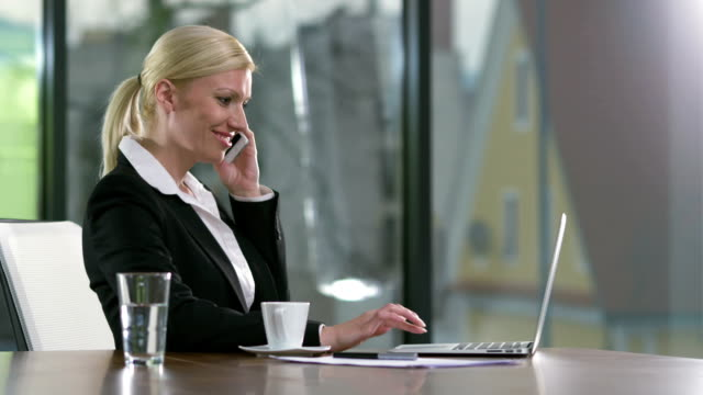 ms businesswoman talking on the mobile phone - blonde hair stock videos & royalty-free footage
