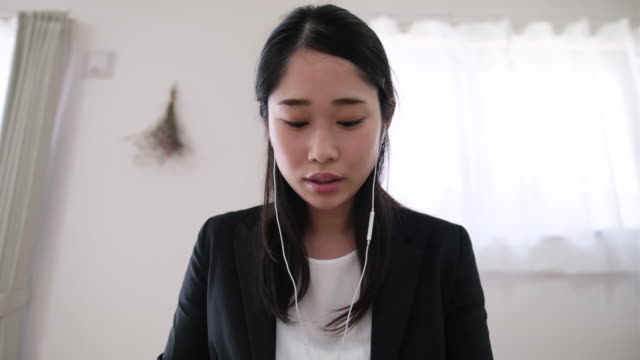 businesswoman talking on video call at home - raw footage stock videos & royalty-free footage