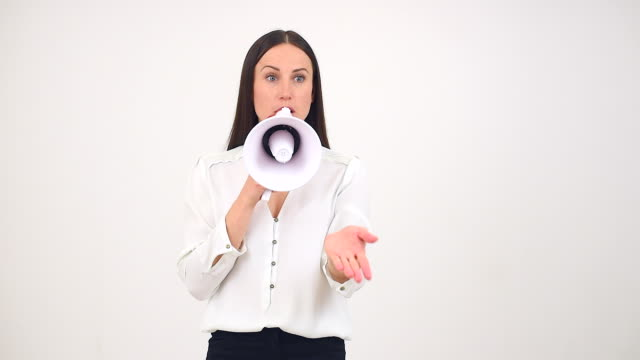 Businesswoman talking through a megaphone