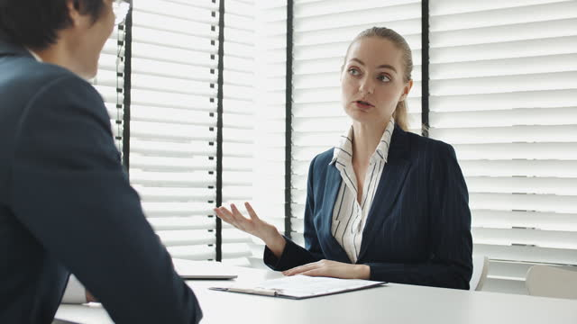 businesswoman talking with applicant businessman at job interview, job interview resume - financial advisor stock videos & royalty-free footage