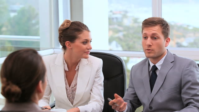 Businesswoman talking with executives