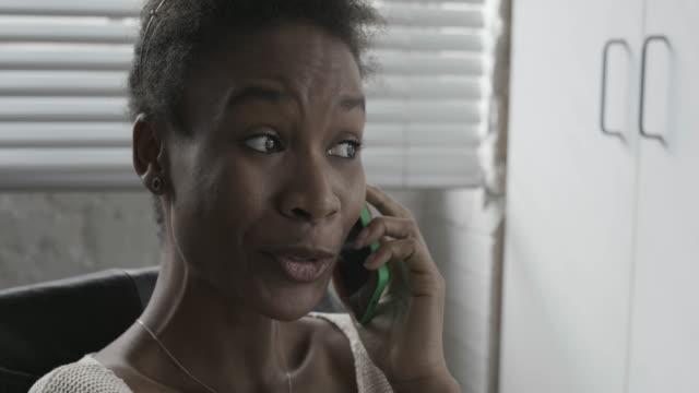 Businesswoman talkingon mobile in office