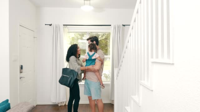 businesswoman tells family goodbye as she leaves for the office - house husband stock videos & royalty-free footage