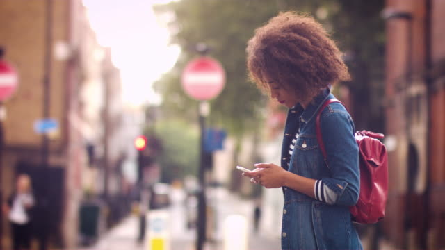 businesswoman text messaging on mobile phone - curly stock videos & royalty-free footage