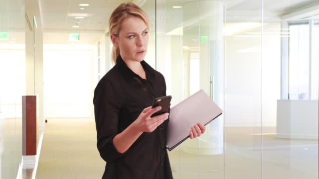 businesswoman texting before going into a meeting - ladder of success stock videos & royalty-free footage