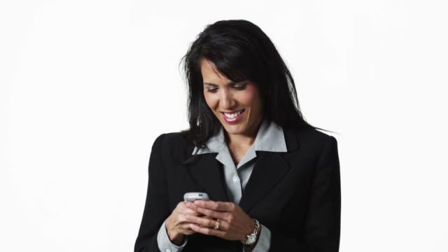 ms businesswoman text-messaging, against white background / orem, utah, usa - polynesischer abstammung stock-videos und b-roll-filmmaterial