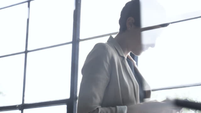 businesswoman texts on phone in office, close up - multiple exposure stock videos & royalty-free footage