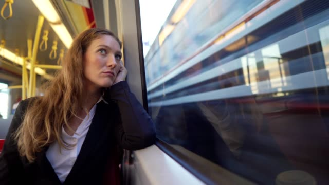 businesswoman traveling by the train - rush hour stock videos & royalty-free footage
