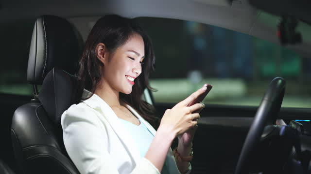 businesswoman use phone in car - land vehicle stock videos & royalty-free footage