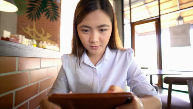 Businesswoman use smart phone at cafe