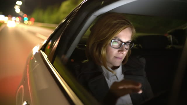 ms businesswoman using a digital tablet while driving to the airport - businesswoman stock videos & royalty-free footage