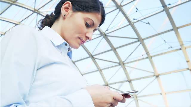 Businesswoman using a mobile phone.