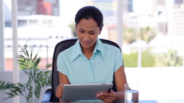 businesswoman using a tablet computer - only mid adult women stock videos and b-roll footage