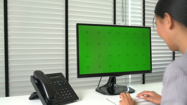 businesswoman using computer green screen - computer monitor mockup stock videos & royalty-free footage