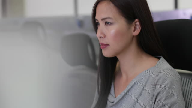 Businesswoman using computer in empty office